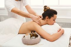Woman getting classical back and neck massage. Classical neck and back massage, closeup. Woman enjoying spa treatment at salon. Wellness, beauty and health care royalty free stock image