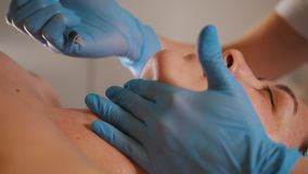 Woman getting a cosmetic procedure - mask facial massage at spa salon skincare. Close up stock video footage