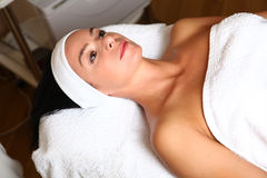 Woman getting cream spa lotion. On face for beauty treatment Stock Photos