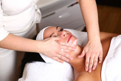 Woman getting cream spa lotion. On face for beauty treatment Stock Photo