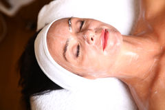 Woman getting cream spa lotion. On face for beauty treatment Royalty Free Stock Photos