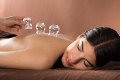 Woman getting cupping treatment at spa Royalty Free Stock Photos