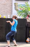 Woman getting into dancing in front of speakers at pre-concert Jimmy Buffet party at Power and Light District in Kansas City MO Ma stock images
