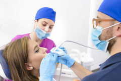 Woman Getting Dental Treatment Royalty Free Stock Photo