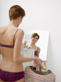 Woman getting dressed Stock Images