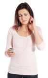Woman getting earache from MP3 player Stock Images