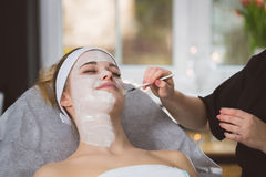 Woman getting enzymatic peeling at beautician`s Stock Images