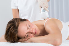 Woman Getting Epilation Laser Treatment Royalty Free Stock Photography