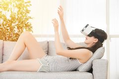 Woman getting experience using VR headset Stock Image
