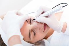Woman getting eyebrow treatment royalty free stock image