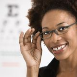 Woman getting eyeglasses royalty free stock image
