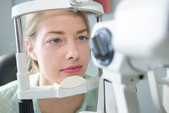 Woman getting eyes tested stock photography