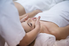 Woman Getting Face And Head Massage In Spa Salon Stock Photos