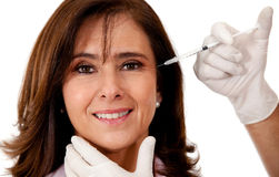 Woman getting a face lift Stock Photos