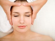 Woman getting a face massage Royalty Free Stock Photography