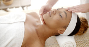Woman Getting A Face Massage Stock Photography