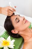 Woman Getting A Face Treatment Royalty Free Stock Photo