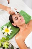 Woman getting a face treatment stock photos
