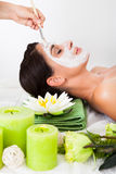 Woman getting a face treatment Royalty Free Stock Image