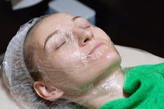 Face peeling mask, spa beauty treatment, skincare. stock photo