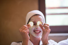 Woman is getting facial clay mask at spa royalty free stock photos