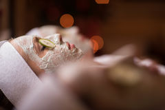 Woman is getting facial clay mask at spa Royalty Free Stock Photography