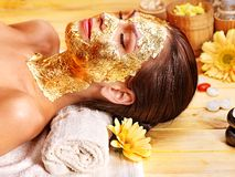 Woman getting  facial mask . Stock Images