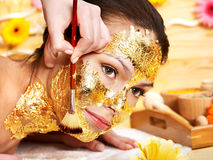 Woman getting  facial mask . Stock Photography