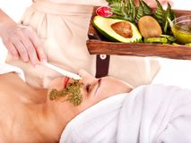 Woman getting facial mask in spa . Stock Images