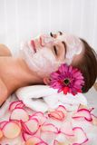 Woman getting facial mask at spa studio Stock Photography