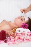 Woman getting facial mask at spa studio Royalty Free Stock Photo