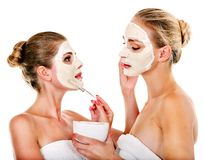 Woman getting facial mask. Royalty Free Stock Images
