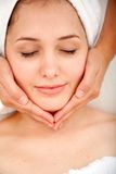 Woman getting a facial massage Stock Photos