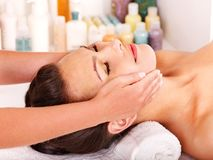 Woman getting  facial massage . Stock Photography