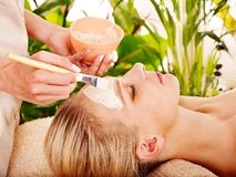 Woman getting  facial massage . Stock Photos