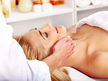 Woman getting  facial massage . Royalty Free Stock Photography