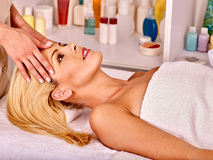 Woman getting  facial massage Stock Photography