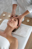 Woman getting a facial massage Stock Image