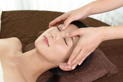 Woman getting a facial massage Stock Images