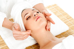 Woman getting facial massage in spa salon. Spa face massage, facial treatment in spa salon Royalty Free Stock Photos