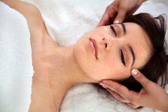 Woman getting a facial treatment Royalty Free Stock Images