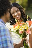 Woman getting flowers. Royalty Free Stock Photos