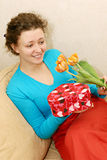 Woman getting flowers and gift Stock Photo