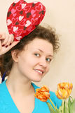 Woman getting flowers and gift Royalty Free Stock Photos