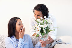 Woman getting flowers from her boyfriend Royalty Free Stock Image