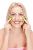 Woman getting fruit cosmetic facial mask Stock Photography