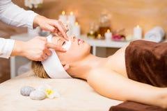 Free Woman Getting Gel Eye Mask Stock Images - 66133114
