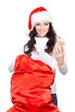 Woman getting the gift from big red sack Stock Photography