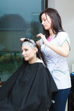 Woman getting hair colored in beauty salon Royalty Free Stock Photos
