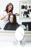 Woman getting hair colored in beauty salon Royalty Free Stock Photography